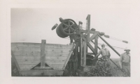 Two men working at the Alouette Peat Farm c.1940s