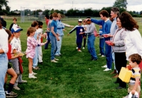 waterballoon toss between adults and children for Sports Day activities C.June 1987