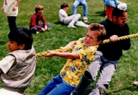Boys pulling rope in tug of war, boy in yellow shirt C.1987/88