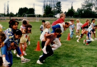 Piggyback races outside on a field for Sports Day activities C.June 1987
