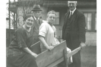 William and Jeannie Struthers posed with friends, Dr. and McCallum, on the south side of the General Store building. It is noted the living room windows are different from those in place today. 1924c.