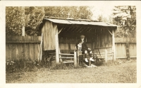 Photo of Robert Struthers as a child sitting with a dog. Likely shot in the early 1920