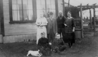William, Jeanin, and Robert Struthers outside of store in 1924c.