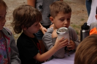 Two boys making butter during our Heritage Thursday 2018 session