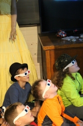 Children watching a 3-D movie