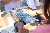 A child making an acrylic pour painting