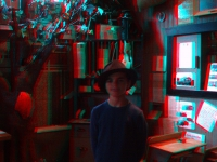 A little boy dressed up for his 3-D photograph