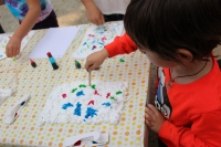 A child preparing his foam for his paper marbling