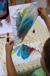 A child marbling his paper