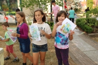 Children showing off their marbled paper