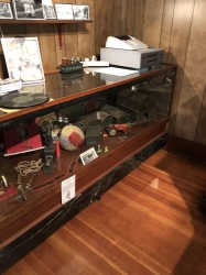 Photo of the toy case in the parlor before