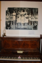 Photo of the piano and new image in the room