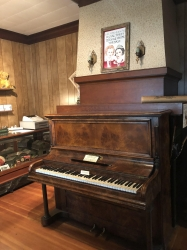 Photo of the piano in the parlour before